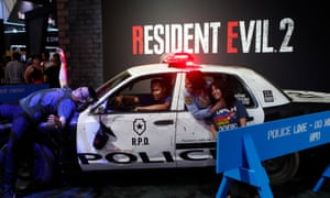 Attendees pose for a souvenir photo at Capcom's Resident Evil 2 booth