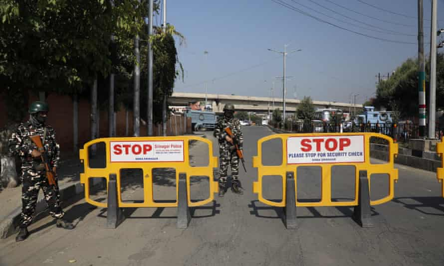 Paramilitary personnel guarding a roadblock on the road near Syed Ali Shah Geelani's grave in Srinagar on Thursday.