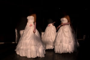 Girls stand outside of their friend's quinceañera venue as they wait for their big entrance