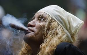 A spiritual healer known as a madrina starts a ritual on the mountain