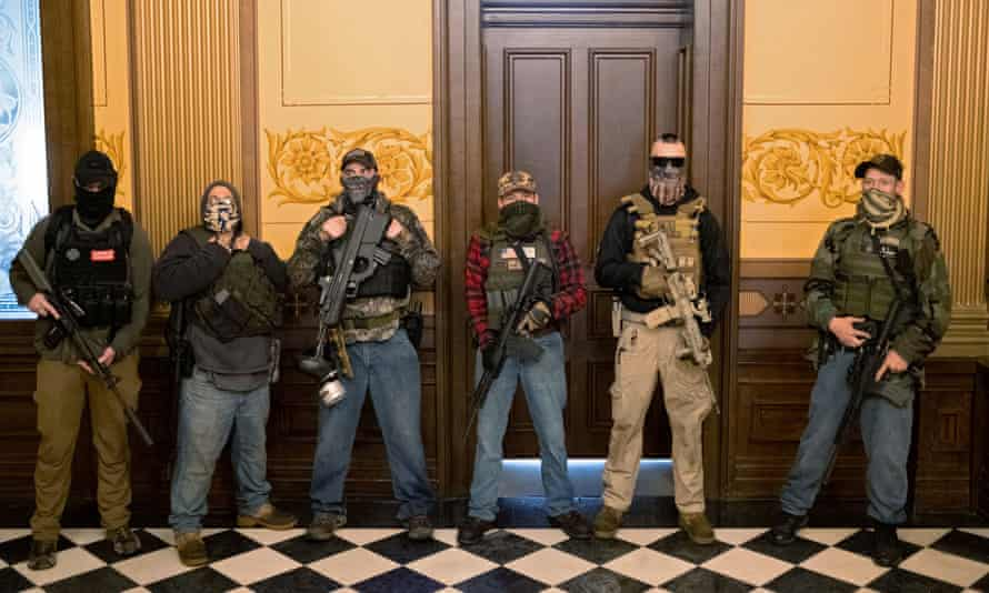 A militia group stands in front of the governors office.