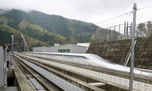 A magnetically levitating train operated by Central Japan Railway Co. making a test run is seen on an experimental track in Tsuru, Yamanashi Prefecture, in this photo taken by Kyodo 21 April, 2015.