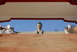 The giant Buddha Dordenma statue at the entry to the Thimphu Valley now shares space with modern telecom towers.