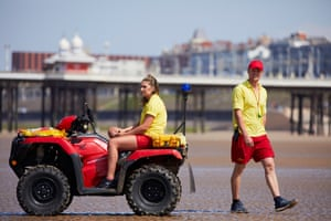 Lifeguards keep watch over the beach at the start of the school holiday season