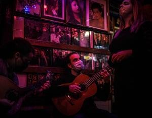 Musicians perform at Tasca do Chico fado house in the Bairro Alto neighbourhood of Lisbon, 12 November