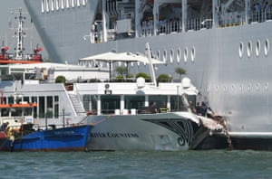 Rescuers stand onboard the damaged River Countess tourist boat after it was hit by the MSC Opera cruise ship in Venice, Italy