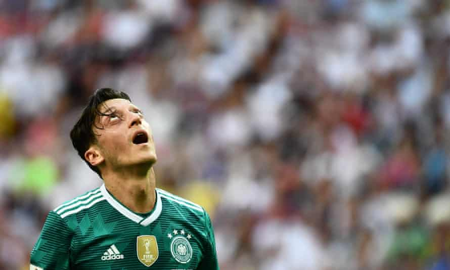 Mesut Özil reacts after Germany's shock defeat by South Korea in the World Cup last month.