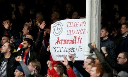 Arsenal fans display a banner saying