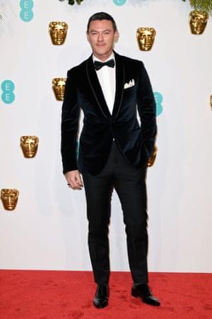 Tuxed up … Luke Evans arrives on the red carpet in a velvet Corneliani suit