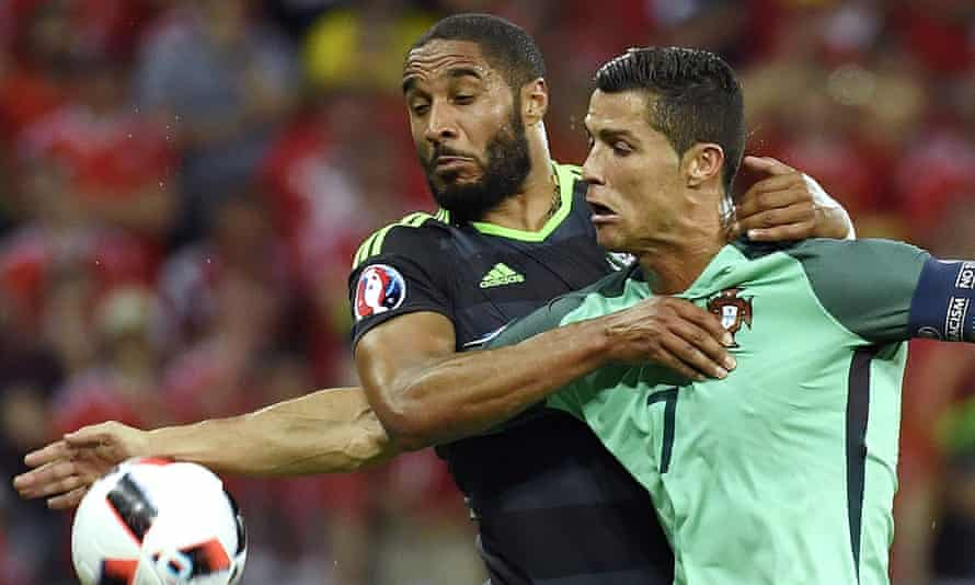 Ashley Williams tussles with Cristiano Ronaldo during Wales's semi-final defeat to Portugal in Lyon