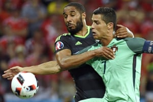 Wales' Ashley Williams gets to grips with Cristiano Ronaldo.