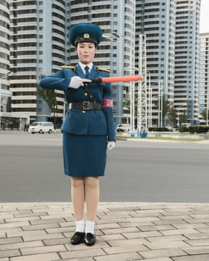 O Yong Ae, a traffic woman, poses in the centre of Pyongyang (October 2017)