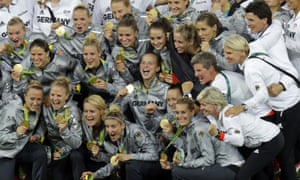 Germany's players celebrate with their golds after beating Sweden
