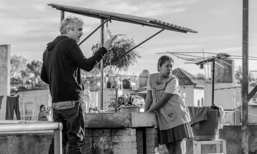 The director Alfonso Cuarón and the actor Yalitza Aparicio, who plays Cleo, on the set of Roma.