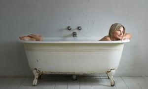 Decca Aitkenhead in a white roll-top bath