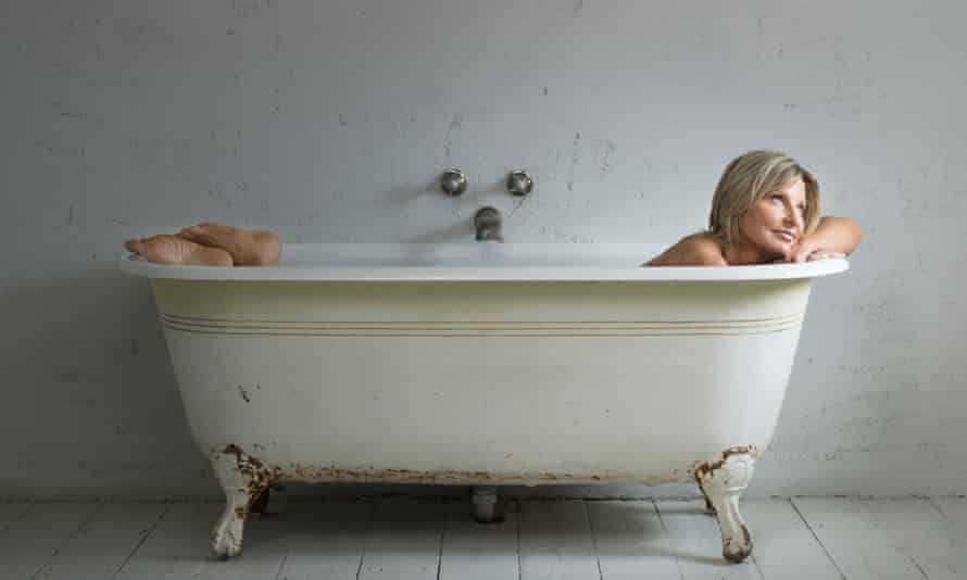 Decca Aitkenhead in a white roll-top bath