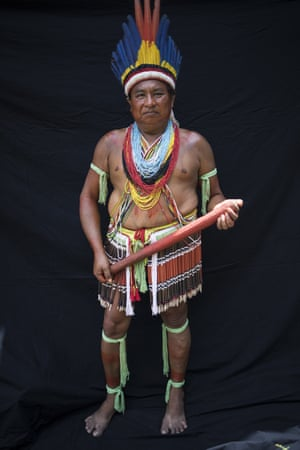 Paulo Sergio Tembe, 49, poses for a portrait during a meeting of the Tembe tribes in the Tekohaw village, in the Alto Rio Guama Indigenous Reserve, in Brazil's Para state. Tembe warriors wear colorful headdresses of macaw and other feathers, and wield bow and arrows that they use to hunt and protect their homeland, which is constantly under threat in the globally vital Amazon region