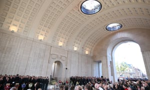 Poppies fall through the interior of the Menin Gate during the Last Post ceremony during the centenary commemorations of Passchendaele.