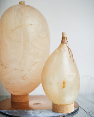 Lights made from a cow's bladder cohabit with vases made of lava