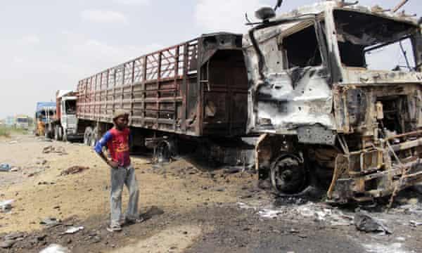 Burnt-out trucks litter the Hays district in Hodeidah province, near Sana'a