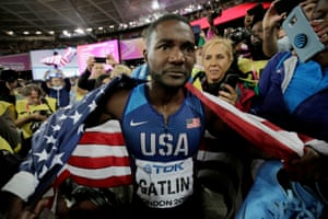Justin Gatlin has tears in his eyes as he celebrates with friends in the crowd.