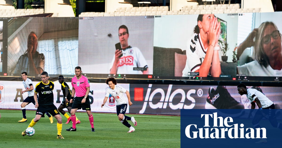 Football fans take usual places via Zoom as matches restart in Denmark – video