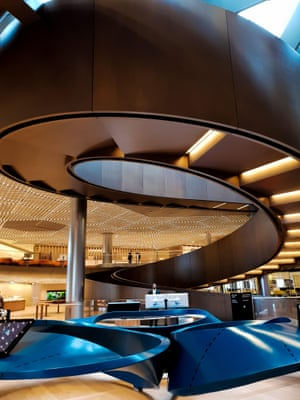 Interior Bloomberg HQ. A great bronze ramp coils through the floors.