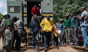 Pastor Evan Mawarire (in yellow top) arrives at Harare magistrates court.