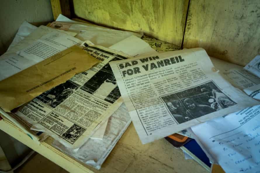 Newspaper cuttings recall Vanriel's boxing heyday.