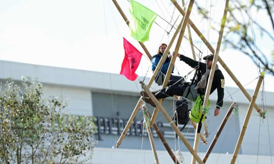 Extinction Rebellion protesters use bamboo lock-ons to block the road outside the Rupert Murdoch-owned Newsprinters works in Hertfordshire on 5 September.