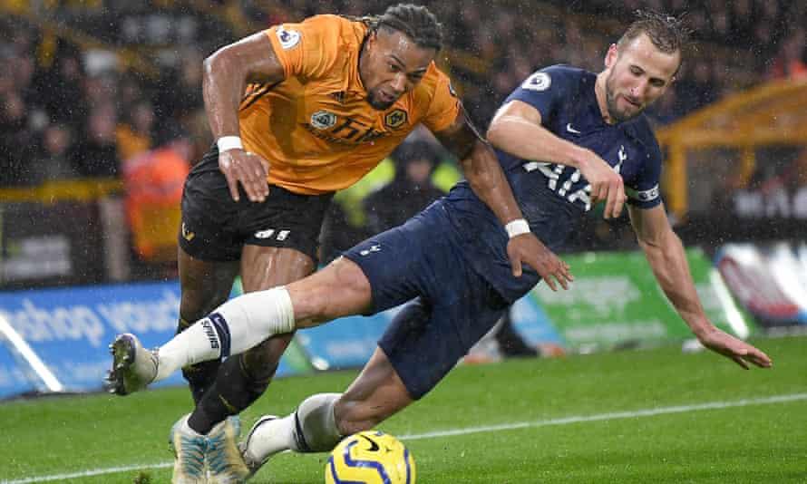 Wolves goal-scorer Adama Traore battles for possession with Spurs striker Harry Kane.
