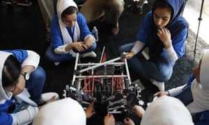 The Afghanistan team fixes their robot in between rounds challenge Monday in Washington.