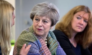 Theresa May listens to students at Tech Pixies, a social enterprise foundation in Oxford aimed at helping mothers return to work.