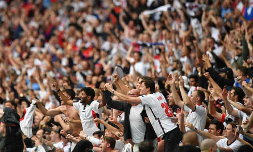 England supporters celebrate the win against Germany at Wembley stadium in London on 29 June