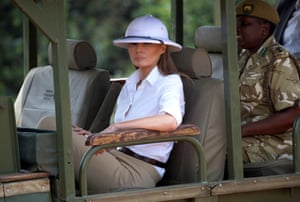 Trump sits in an open tour vehicle during a game drive at Nairobi National Park, Kenya