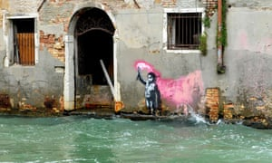 Venice, ItalyAn alleged work by British street artist Banksy depicting a migrant child wearing a lifejacket holding a pink flare, is painted on the outer wall of a house overlooking the canal Rio de Ca Foscari.