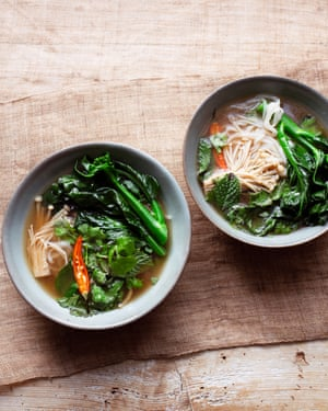 Serve in deep bowls: broth, winter greens, rice noodles.