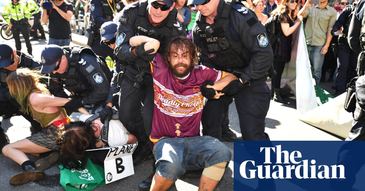 Queensland police arrest 56 climate change protesters in Brisbane