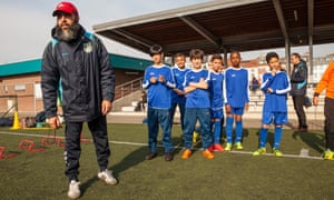 Azmani Ridoin oversees his young players at the Académie Jeunesse Molenbeek's training ground