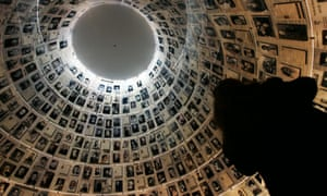 a visitor to the Hall of Names at the Yad Vashem Holocaust Memorial Museum in Jerusalem.