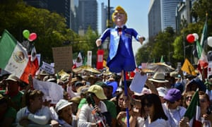Thousands of Mexicans take part in an anti-Trump march in Mexico City.