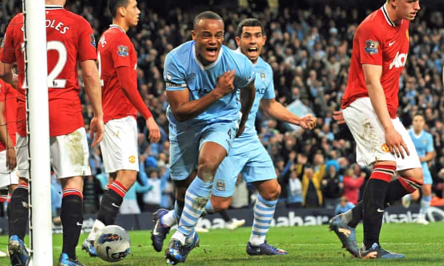Kompany celebrates scoring the decisive goal against Manchester United in April 2012 to set City on their way to their first Premier League title win.