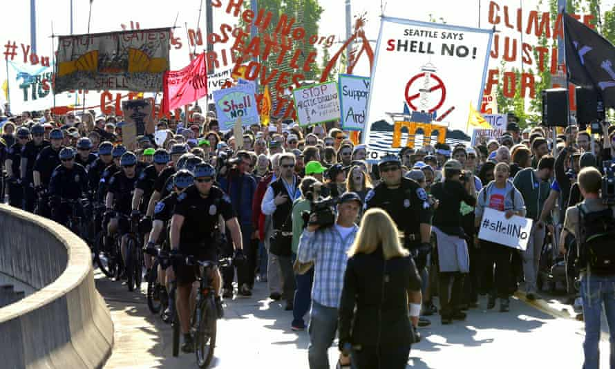 Demonstrators march through Seattle, Washington, on Monday, in protest against Arctic oil drilling following a lease agreement between Shell and the city's port. (AP Photo/Ted S. Warren)