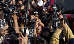 Rubi Ibarra arrives at Mass surrounded by a horde of journalists.