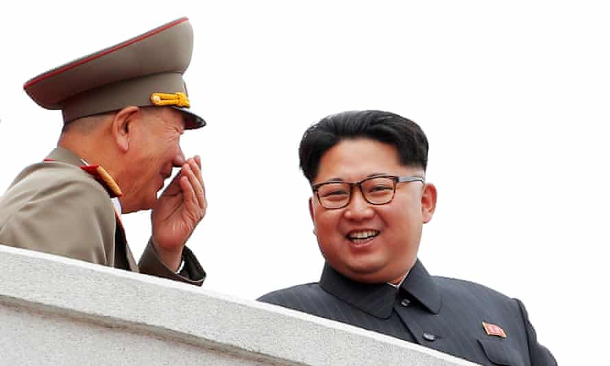 Kim Jong-un, right, watched the mass rally alongside high party and military officials.