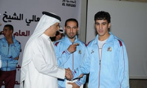 Hakeem Al-Araibi (right) with Sheikh Salman bin Ebrahim al-Khalifa, the president of the Asian Football Confederation.