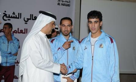 Hakeem Al-Araibi (right) with Sheikh Salman bin Ebrahim al-Khalifa, the president of the Asian Football Confederation.