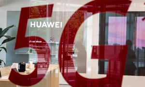 A shop for Chinese telecoms giant Huawei features a red sticker reading '5G' in Beijing