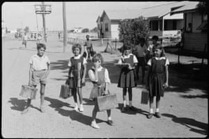 Schoolchildren at Moree Aboriginal Reserve (left to right): Stanley Binge, Heather Hammond, Jackie Cain, Julie Munro and unknown child. Woman at the window, Molly French