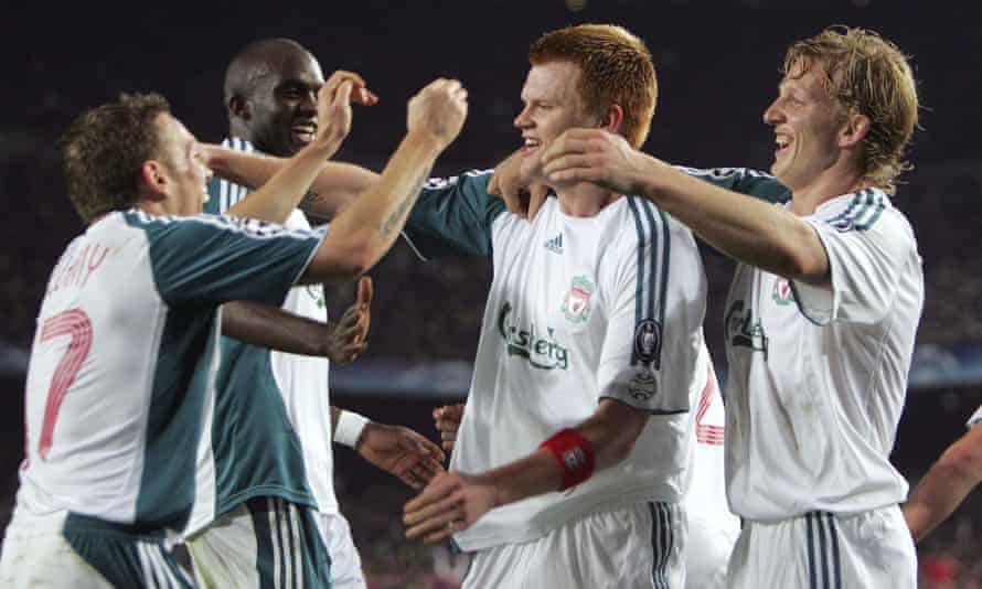 Bellamy and Riise embrace in celebration following the Norwegian's decisive goal for Liverpool in the same game against Barcelona.